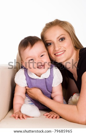 portrait of a cute mom with her little daughter