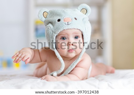 Portrait of a cute 5 months baby lying down on a blanket - stock photo