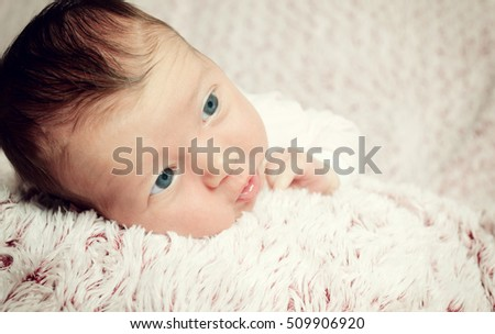 Portrait of a cute newborn baby girl.