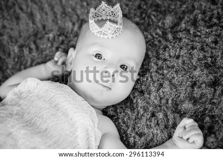 Portrait of a cute newborn boy with a crown ( black and white )