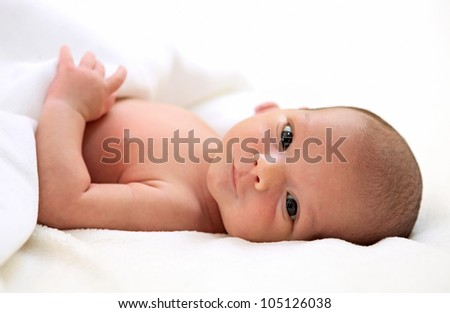 Portrait of a cute one-week old baby boy - stock photo