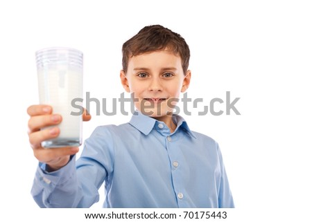 Portrait of a cute schoolboy with a glass of milk, isolated on white background - stock photo
