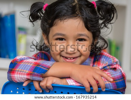 Portrait of a Cute Smiling Little Girl - stock photo