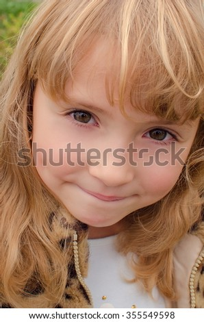Portrait of a cute smiling little girl close-up