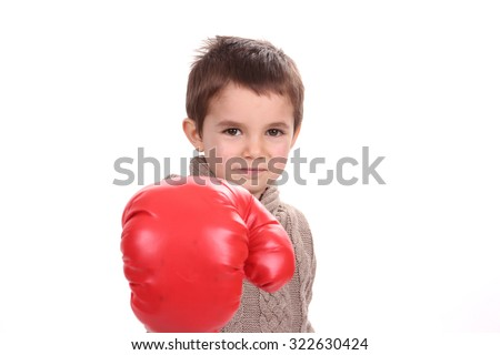 Portrait of a cute sporty boy in boxing gloves - stock photo
