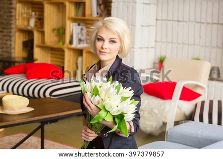 Portrait of a cute student girls with a bouquet of white flowers. natural makeup. tulips