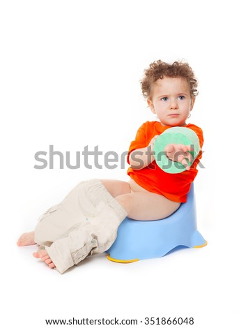Portrait of a cute surprised little  baby boy kid child  girl on potty with lavatory paper, isolated on white background