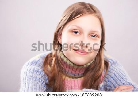 Portrait of a cute teen girl, studio shot - stock photo