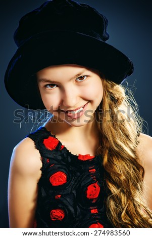 Portrait of a cute teen girl wearing beautiful festive dress. Beauty, children's fashion. Studio shot.