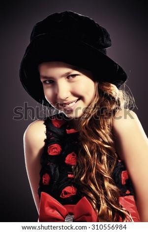 Portrait of a cute teen girl wearing beautiful festive dress. Beauty, children's fashion. Studio shot. - stock photo