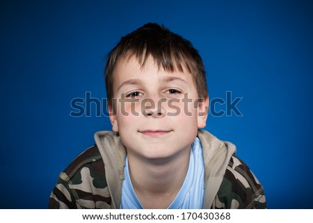 portrait of a cute teen on blue background - stock photo