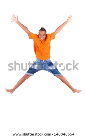 Portrait of a cute teenage black boy jumping over white background - African people - stock photo