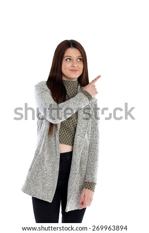 Portrait of a cute teenage girl pointing at copyspace on white background - stock photo