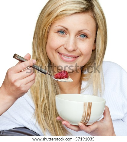 Portrait of a cute woman eating healthy food against white background