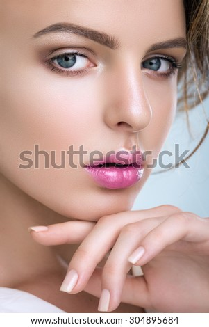 Portrait Of A Cute Woman On A Blue Background - stock photo