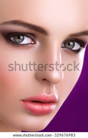 Portrait Of A Cute Woman On A Purple Background
