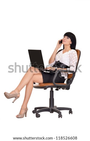 portrait of a cute woman sitting on an office chair - stock photo
