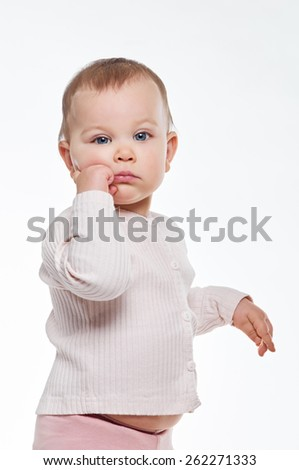 Portrait of a cute 1 year old baby on white background