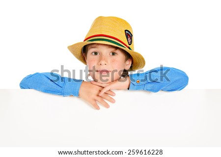 Portrait of a cute 7 year old boy standing with white board. Isolated over white background. Copy space. - stock photo