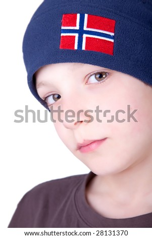 Portrait of a cute young boy isolated on white background. Studio shot.