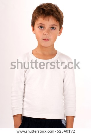 Portrait of a cute young boy with beautiful green eyes