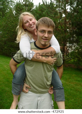 Portrait of a cute young couple, girl on piggy-back