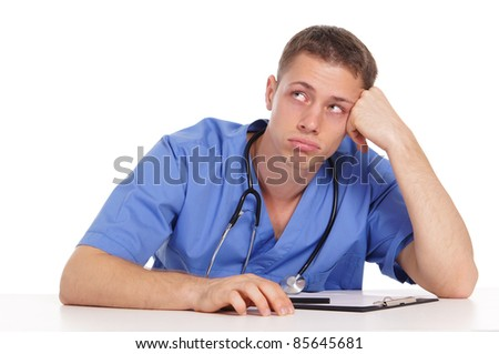 portrait of a cute young doctor at table