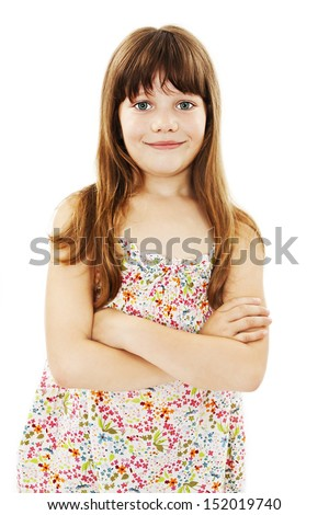 Portrait of a cute young girl standing with folded hands over white background - stock photo