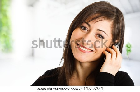 Portrait of a cute young woman talking at phone
