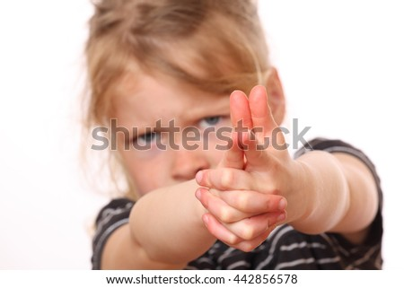 Portrait of a dangerous young girl on white background - stock photo