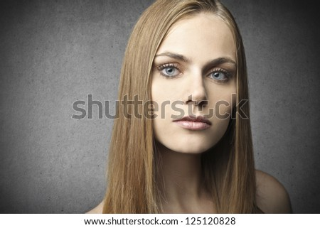 Portrait of a dark blonde woman with blue eyes - stock photo