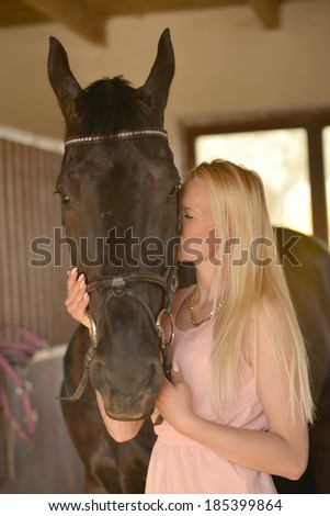 Portrait of a dark horse and woman  - stock photo