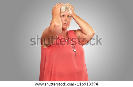 Portrait Of A Depressed Senior Woman On A Gray Background - stock photo