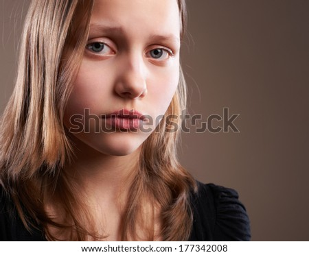Portrait of a depressed teen girl - stock photo