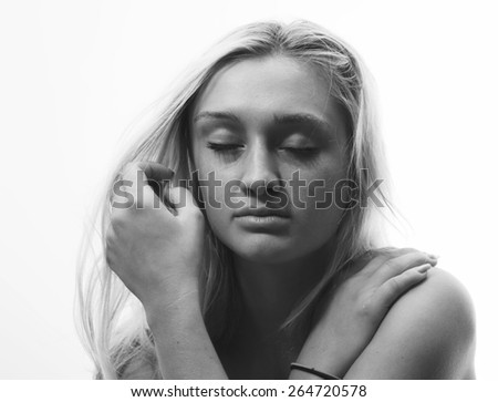 Portrait of a depressed young woman - stock photo