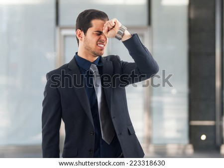 Portrait of a desperate businessman - stock photo