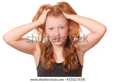 Portrait of a desperate young girl on white background - stock photo