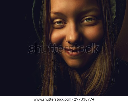 Portrait of a devil teen girl with a sinister smile, closeup