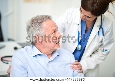 Portrait of a disabled patient talking to a doctor