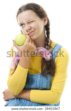 Portrait of a dissatisfied teenager girl with apple standing and smile,isolated on white - stock photo