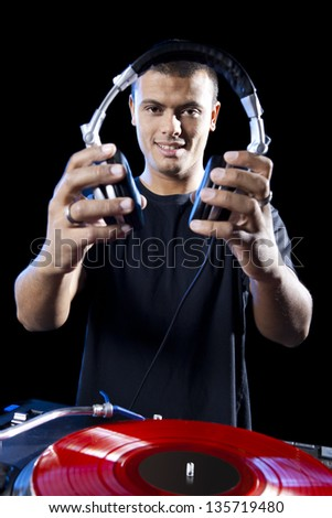 Portrait of a DJ playing disco electro music in a concert