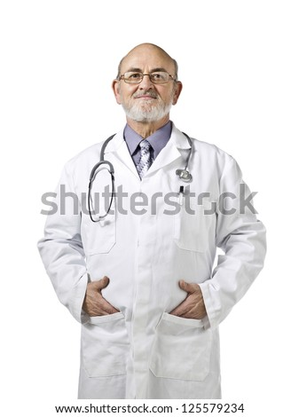 Portrait of a doctor standing on a white background with hands on his pockets - stock photo
