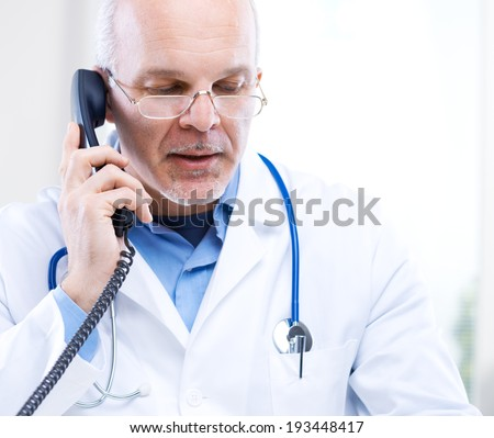 Portrait of a Doctor talking on the phone
