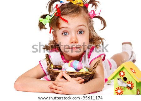 Portrait of a Easter kid embracing wicker basket with egg decoration - stock photo