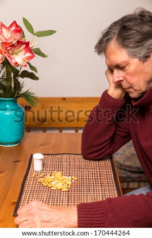 portrait of a elderly man with medications - stock photo