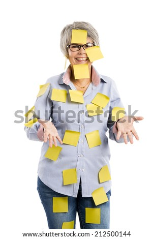 Portrait of a elderly woman with yellow notes all over the body - stock photo