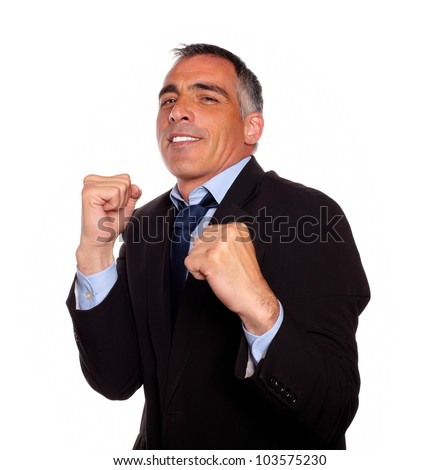 Portrait of a elegant latin business man on black suit boxing against white background - stock photo