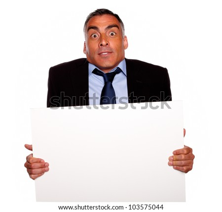 Portrait of a elegant surprised hispanic senior man holding a white card with copyspace on isolated background - stock photo