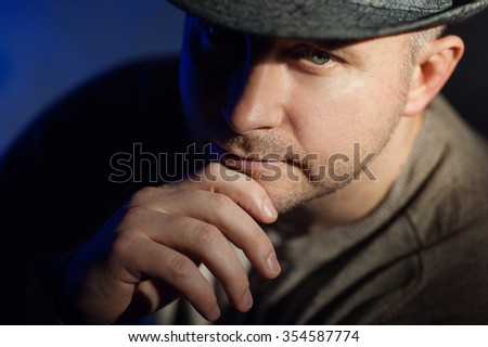 Portrait of a elegant young man in hat. - stock photo