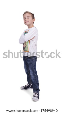 Portrait of a elementary boy with arms crossed standing against white background - stock photo